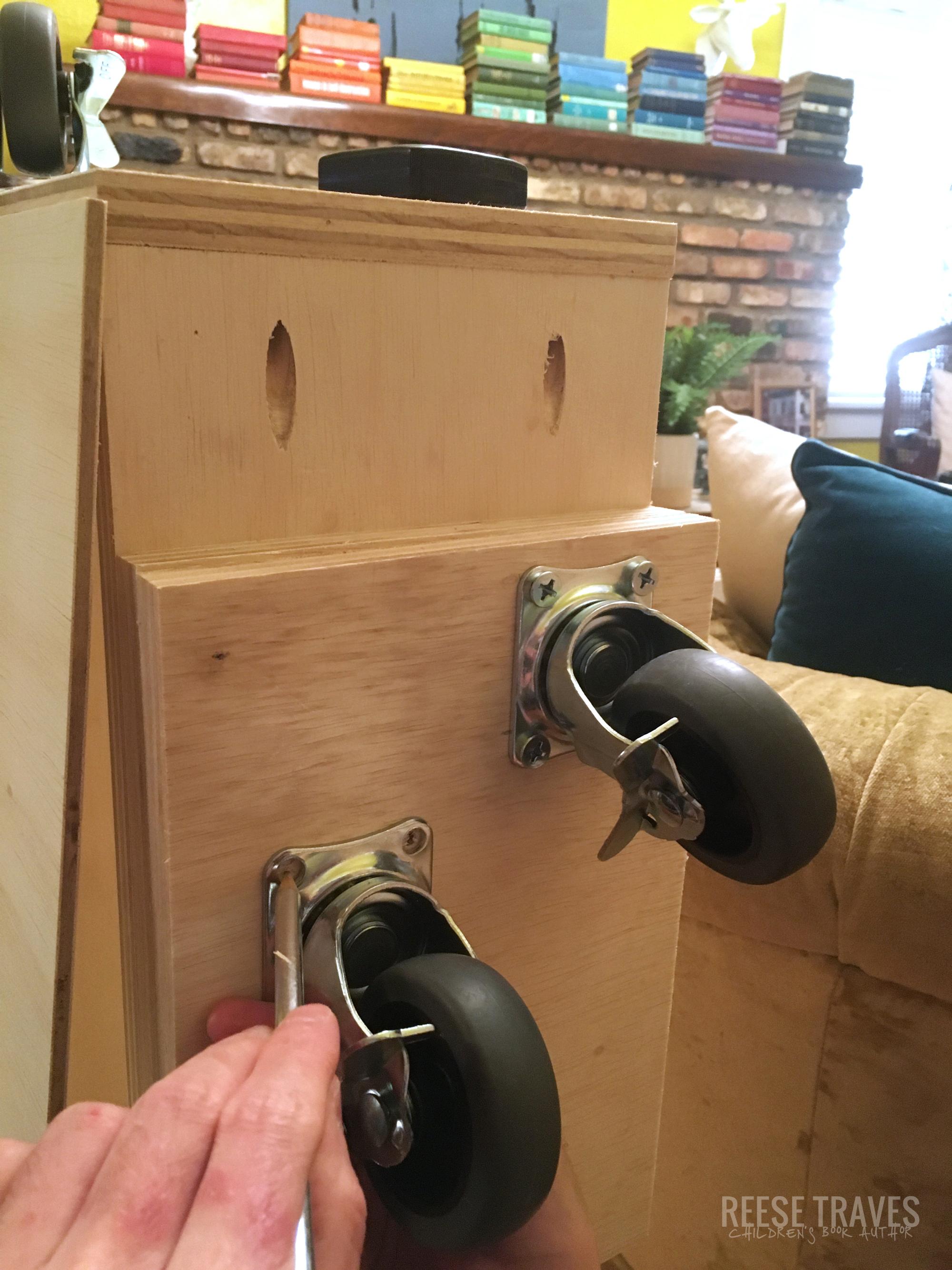 Casters on the bottom of hidden bookcase door.